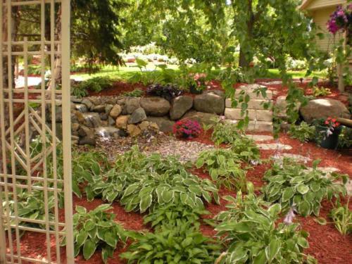 OutdoorArtsLandscape thuelandscaperenovation plantswaterfeature 013