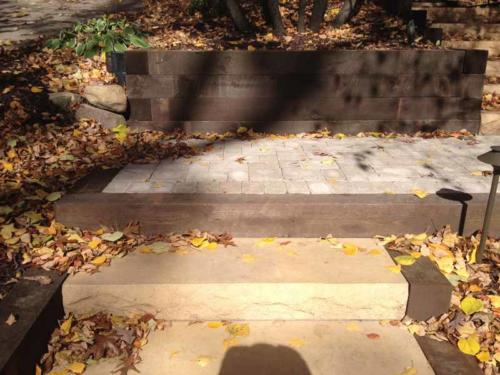 TIMBER WALLS, CONCRETE STEPS, FRONT ENTRY