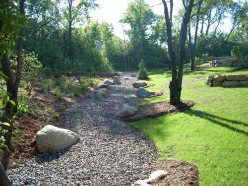 OutdoorArtsLandscape ChavarininWallsFP PlantingRiverbed 000